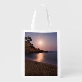 Purple Sunset beach Catalonia, Spain Grocery Bag