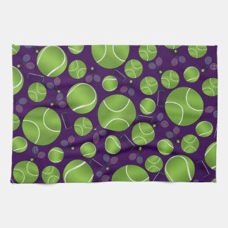 Purple tennis balls rackets and nets towels