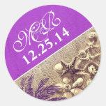 purple wedding sticker with palm seashell monogram