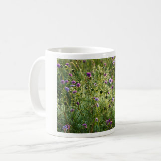 Purple wild flowers in a green meadow coffee mug