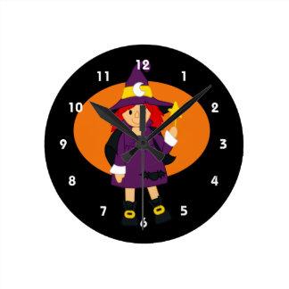 Purple witch cartoon orange behind round clocks