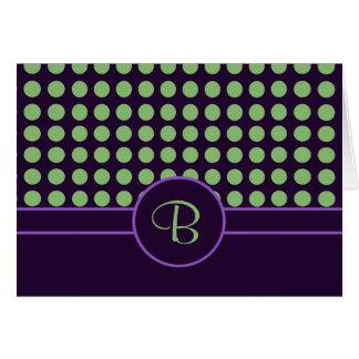 Púrpura con el monograma verde de los lunares felicitación