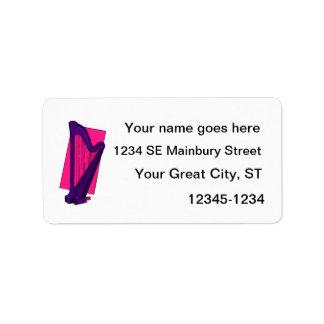Púrpura de la arpa del pedal con el fondo rosado etiquetas de dirección