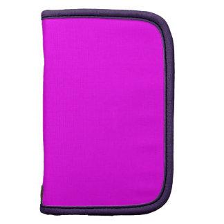 Púrpura rosada de neón brillante del fondo del planificador