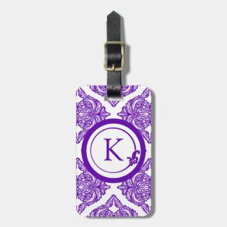 Púrpura y blanco adornados del damasco etiqueta de maleta
