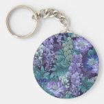 Púrpura y flores de la selva del trullo llavero redondo tipo chapa