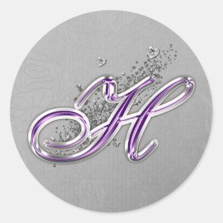 Púrpura y pegatina del monograma H del brillo de