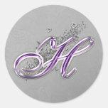 Púrpura y pegatina del monograma H del brillo de l