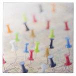 Pushpins in a map 2 ceramic tiles