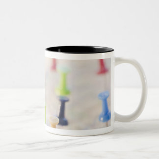 Pushpins in a map 2 mugs