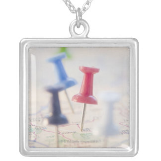 Pushpins in a map square pendant necklace