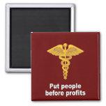 Put people before profits fridge magnet