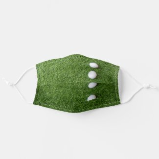 Putter is on green grass cloth face mask