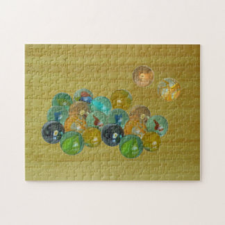 Puzzle - Glass marbles on bamboo floor
