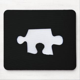 Puzzle piece mouse pad