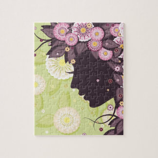 Puzzle with woman face silhouette and flowers