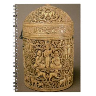 Pyx con el alivio que representa los placeres de c spiral notebooks