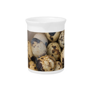 Quails eggs in a bowl pitcher