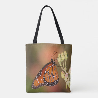 Queen butterfly on a branch tote bag