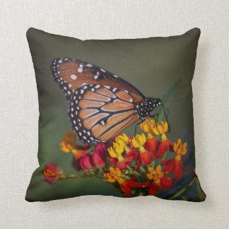 Queen on tropical milkweed throw pillow