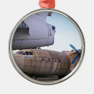 Queing never to fly again. round metal christmas ornament