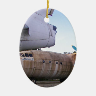 Queing nunca a volar otra vez adorno ovalado de cerámica