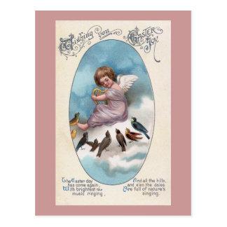 Querube y pájaros en el vintage Pascua de la nube