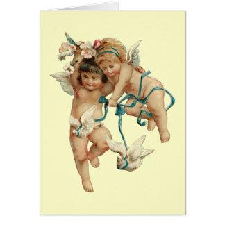 Querubes con las palomas blancas tarjetas