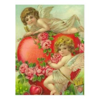 Querubes y corazones dulces postal