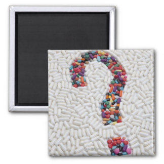 Question mark of pills on white pill background magnet