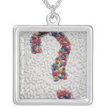 Question mark of pills on white pill background square pendant necklace