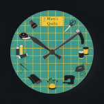 "Quilt Time Customize the Label Round Clock<br><div class=""desc"">Here's my special design for fellow quilters with my favorite tools and supplies for quilting, patchwork, needlework and embroidery: sewing needles, spools of thread, pin cushion with stick pins, bobbins, thimble, tape measure, scissors, bolt of cloth, rotary cutter, sewing machine and label on a green and gold self healing cutting...</div>"