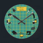 """Quilt Time Customize the Label Round Clock<br><div class=""""desc"""">Here's my special design for fellow quilters with my favorite tools and supplies for quilting, patchwork, needlework and embroidery: sewing needles, spools of thread, pin cushion with stick pins, bobbins, thimble, tape measure, scissors, bolt of cloth, rotary cutter, sewing machine and label on a green and gold self healing cutting...</div>"""