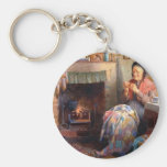 Quilting by the fireplace keychain