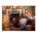 Quilting by the fireplace postcard