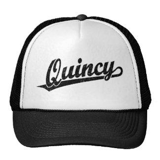 Quincy script logo in black distressed trucker hat