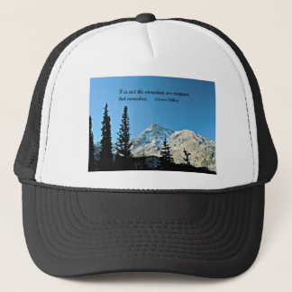 Quote: It is not the mountain we conquer... Trucker Hat