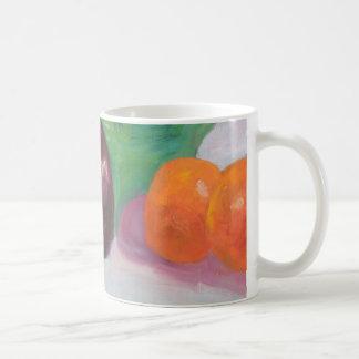 Rábanos berenjena y naranjas taza de café