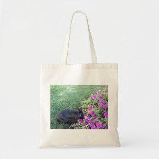 Rabbit in the garden tote bag