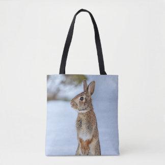 Rabbit in the snow tote bag