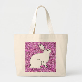 Rabbit on a bed of spring flowers large tote bag