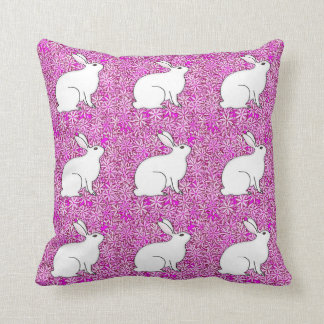 Rabbit on a bed of spring flowers pillows