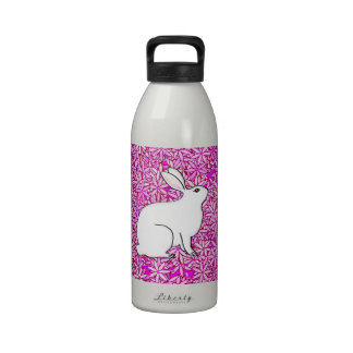 Rabbit on a bed of spring flowers reusable water bottles