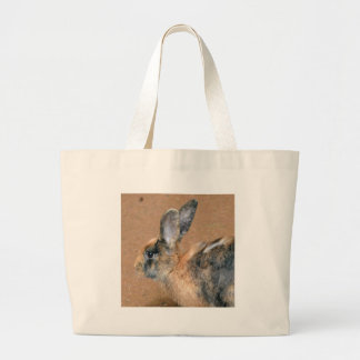 Rabbit on the ground large tote bag