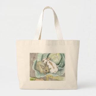 Rabbits and cabbage tote bags