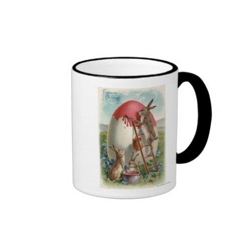 Rabbits Painting an Egg Coffee Mug