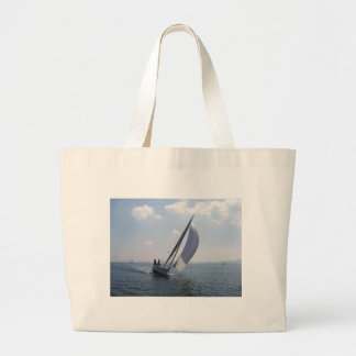 Racing yacht at speed. large tote bag