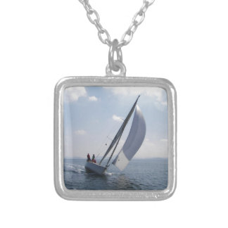 Racing yacht at speed. silver plated necklace
