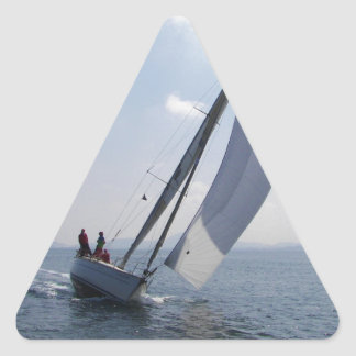 Racing yacht at speed. triangle sticker