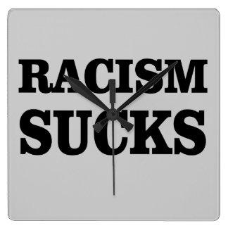 Racism sucks. square wall clock